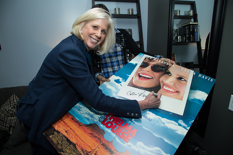 Academy Award-winning writer Callie Khouri autographs the <em>Thelma &amp; Louise</em> one-sheet to celebrate the film&#8217;s 25th anniversary at a March 2016 event hosted by the Committee of Women Writers and the Guild Screenings.